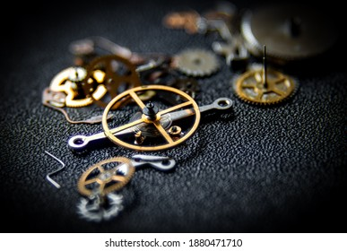 Macro image of watch parts including wheels, cogs and the balance wheel