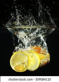 macro juicy slice of lemon in water on a black background Studio