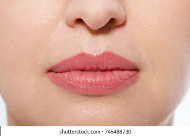 Macro lips makeup. Close up female mouth. Plump full lips. Close-up pores and face details. Collagen and face injections. Anti aging Plastic surgery. Selective focus. Mock up and copy space