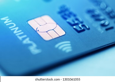 Macro low key with old credit card. Selective focus microchip on a credit card or debit card payment in blue for background