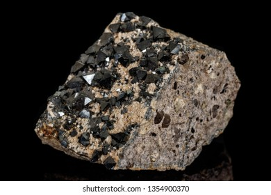 Macro Magnetite mineral stone on black background close up