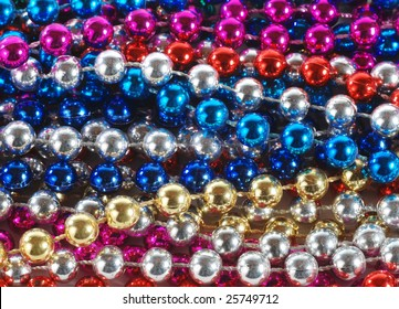 macro of Mardi Gras beads
