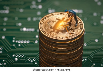 macro miner figurine on shiny bitcoin stack. cryptocurrency concept