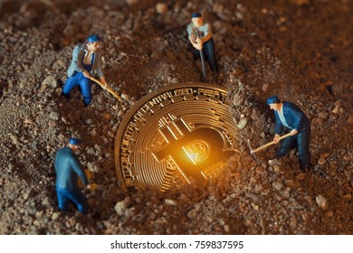 macro miner figurines digging ground to uncover big shiny bitcoin