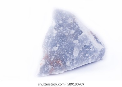 macro mineral anhydrite stone on a white background