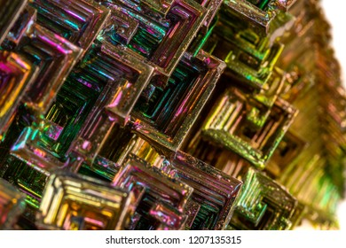 Macro of the mineral bismuth stone on a white background close-up