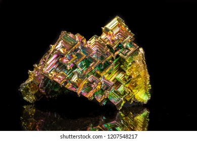 Macro of the mineral bismuth stone on a black background close-up