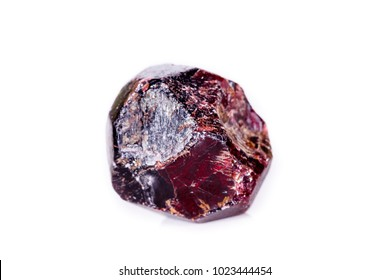 Macro of a mineral garnet stone on a white background close up