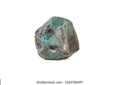 macro mineral stone alexandrite bluish - green with fluorescent light on a white background close-up