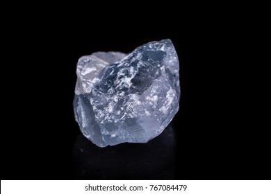 Macro mineral stone angelite on black background close up