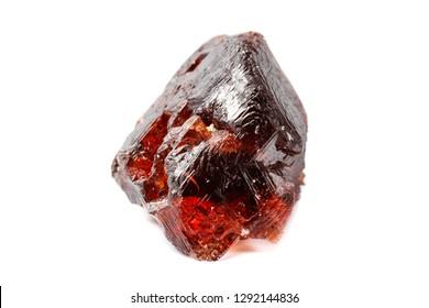 Macro mineral stone Garnet Spessartine on a white background close up