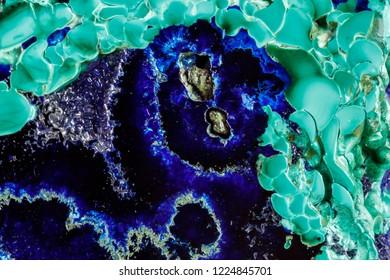 Macro mineral stone malachite with azurite on white background close up