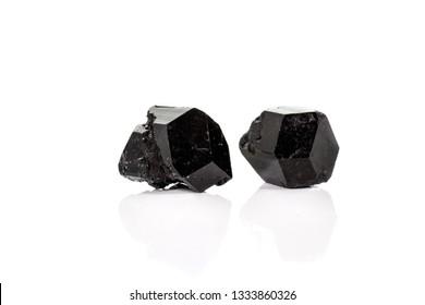 macro mineral stone schorl, black tourmaline on white background close up