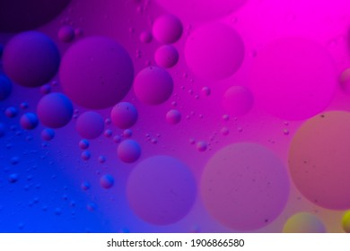 macro oil water photography Abstract background and texture of bubbles light multi color illumination. art water surface for your products display and artwork design with copy space. Watery glare