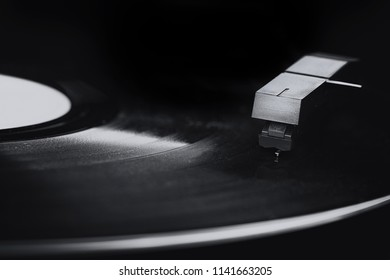 Macro of an old vinyl record player in black and white