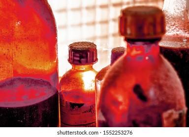 macro on few dark vintage bottles