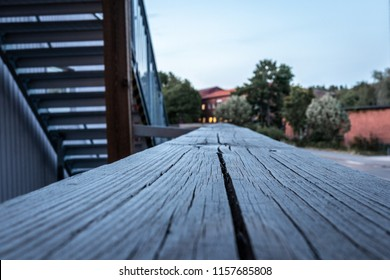 Macro perspective view of wood railing  on building outdoors.