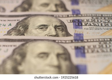 Macro photo of 100 dollar bills in one row. Lots of dollars