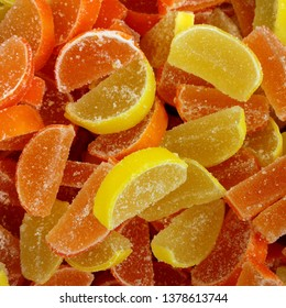 Macro photo artist of multi-colored marmalade jelly candys. Dessert marmalade in the form of lemon and orange slices. The sweetness of jelly candy yellow and orange.