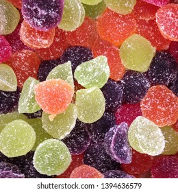 Macro photo artist of multi-colored marmalade jelly candy's. Dessert marmalade in the form of lemon and orange slices. The sweetness of jelly candy yellow and orange.