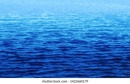 Macro photo background with transparent blue waves of sea water. Example for web background or poster design
