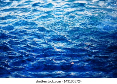 Macro photo background with transparent blue waves of sea water. Example for web background or poster design.
