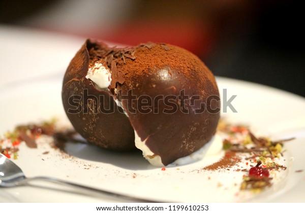 Macro photo of a beautiful chocolate dessert tiramisu on a white plate
