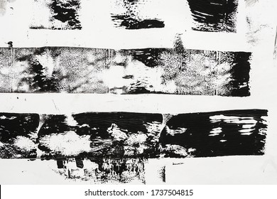 macro photo of black lino ink remain, linocutting paint roller texture on white paper background.