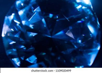 Macro photo of a blue ice cold shining diamond closeup texture.