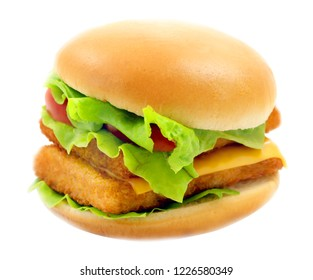 Macro photo of bright fresh isolated burger with fish and salad on white background
