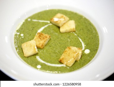 Macro photo of bright tasty cream spinach soup on a plate