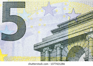 Macro photo. Closeup photo of a part of five euro note.