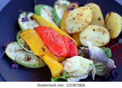Macro photo of delicious different grilled vegetables on a plate in a restaurant
