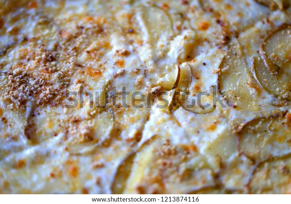 Macro photo of delicious pizza with pear and cheese on a plate in a restaurant