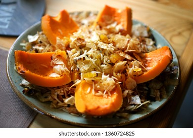 Macro photo of delicious pumpkin with rice and raisins in a cafe in Yerevan