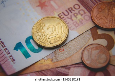 Macro photo of Euro coins on a blurred background banknote in 10 and 50 euro. Money background. Extremely small depth of field.