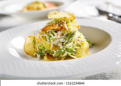 Macro Photo of Exquisite Serving Salad with Crispy Potato Chips and Chopped Strips Vegetables on Blurred Background. Restaurant Starter Menu of Veggie Salat with Thin Sliced Fried Potatoes Close Up