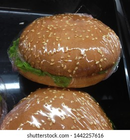 Macro photo fast food burger. Texture background juicy burger with meat and greens. Image of fast food burger pack