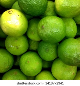 Macro Photo food citrus fruit lime. Texture pattern juicy green tropical lime fruit. Image green limes