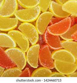 Macro photo food dessert jelly sweets. Texture background lemon and orange jelly sweets. Image of fruit marmalade candy