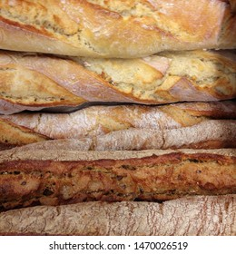 Macro photo food freshly baked bread. Background texture french baguette bread. Loaves of bread lie in rows.