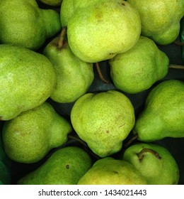 Macro Photo food fruit green pears. Texture background of fresh green pears. Image of fruit product pears