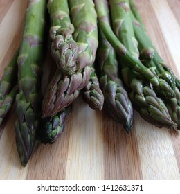 Macro Photo food vegetable asparagus. Texture background of green fresh asparagus sticks. Image of product vegetable stems of green asparagus