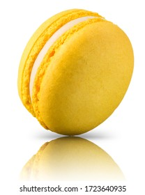 Macro photo of french yellow macaroon isolated on white background.
