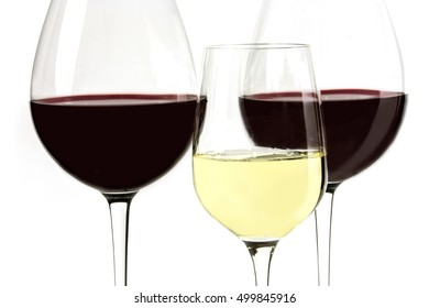 A macro photo of glasses of red and white wine, shot on white background
