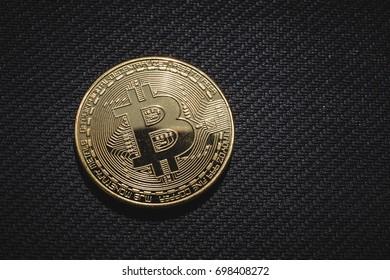 Macro photo of golden coin Bitcoin, network business money concept