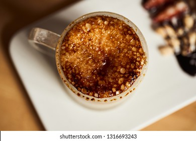 Macro photo of hot latte with baked caramel crust. Food concept. Top view close up image of coffee.