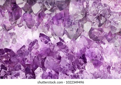 macro photo of lilac amethyst crystals background