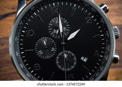 Macro photo of luxury man watch detail, chronograph close up