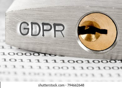 Macro photo of padlock and data on the paper with GDPR words imprinted on metal surface